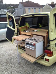 Clever slide-out rear kitchen! You could rig a tent or awning, for the back, to keep you out of the weather.