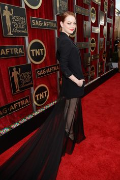 The Boldest Red Carpet Looks From The SAG Awards #refinery29  http://www.refinery29.com/2015/01/81264/sag-awards-2015-red-carpet-pictures#slide-29  Emma Stone has already worn pants on the red carpet, setting the bar high for her daredevil fashion choices, and the actress came through with another unexpected look tonight. Her Christian Dior Couture tuxedo minidress came with a theatrical, sheer train that let her get away with a shorter hemline at a black-tie event.