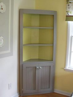 Cute corner cabinet!   Do It Yourself Home Projects from Ana White- perfect in middle room! use as book shelves or display shelves for china.