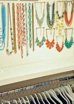 Organized jewelry on push pins. two points for statement necklaces so you can see them better