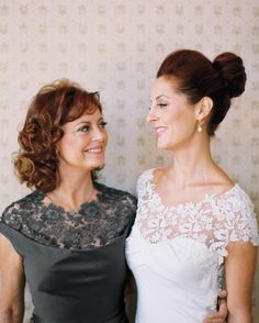 Like mother, like daughter: Lela Rose made a knee-length charcoal dress for Sarandon that complemented the bride's with a similar lace neckline.