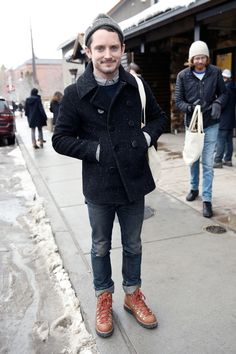 killer hiking boots, jeans, a knit beanie, and a peacoat