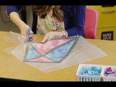 Spring stained glass window kite decorations made from tissue paper and clear contact paper. This kindergarten teacher shares instructions in the blog post.