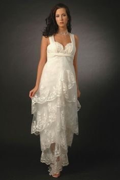 Maternity wedding dress for pregnant brides features lace embellishments. Sweetheart neckline comes with wide shoulder straps. Beautiful organza tiers finish this feminity design with lace appliques. Colors available in Color Options. Custom-to-measurement for any sizes.