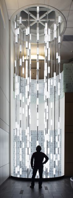 #Snow Words is situated in the lobby of the Crime Detection Laboratory, Anchorage, #Alaska. Measuring 9m high, when viewed from above the tower of light looks as though it is emerging from  the ground. @cécile moreau Balmond