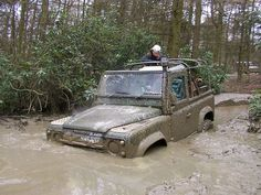land rover defender stuck in mud