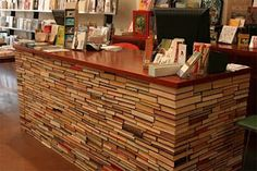 Awesome idea! Upcycled books become a counter at a book store.