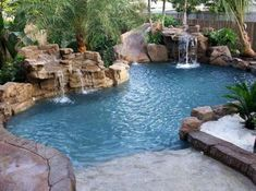 Pool Waterfalls Ideas for Your Outdoor Space backyard grotto pool with waterfall. tropical vacation/entertaining without leaving your home.backyard grotto pool with waterfall. tropical vacation/entertaining without leaving your home. Backyard Beach, Backyard Pool Landscaping, Backyard Pool Designs, Swimming Pools Backyard, Swimming Pool Designs, Lap Pools, Indoor Pools, Beach Pool, Pool Decks