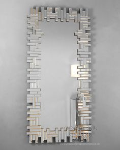 Bolzaneto - Mirrors, This fabulous, quirky, Venetian puzzle mirror, with its rectangular frame can be hung either portrait or landscape fashion. The funky, interlocking, bevelled edged oblongs create a visually stunning `Mirror Art` look and is perfect for that modern space!