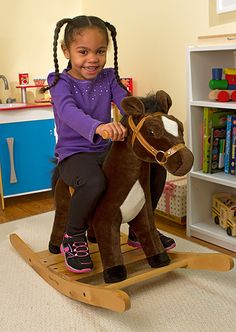 {Rock and Trot Plush Rocking Horse} Sturdy rocking horse with a realistic saddle and bridle. Ready to ride, it makes galloping sounds when its ear is pressed. *Too cute.