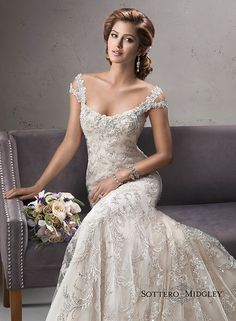 Exquisite beaded embroidered lace on tulle drapes over satin in this stunning fit and flare gown, Ettiene, by Maggie Sottero. Complete with detachable cold-shoulder straps.
