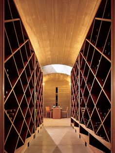 Wine cellar. Modern lines with simple racks.  This is an inexpensive way to create wine storage.