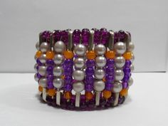 Purple Orange and Faux Pearl Safety Pin Stretch Bracelet. Using purple glass flower spacers at top and bottom.