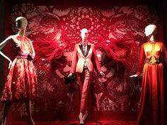 Just so you know, this is the Year of the Dragon. And of course, to join in the celebrations, Bergdorf Goodman did up three of their windows on 58th Street. With majestic paper dragons flying around in the background, the brillant red displays captivate shoppers passing by.