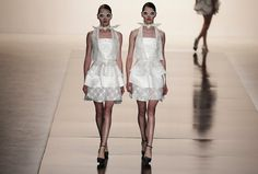 Models present creations from the Acquastudio 2013/2014 summer collection during Sao Paulo Fashion Week in Sao Paulo, Brazil. Photograph: Nacho Doce/Reuters