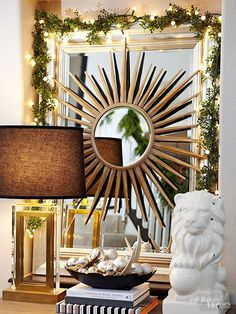 Sparkling Reflections: Set up eye-catching decor in your entryway or living room by draping a mirror with a battery-powered lighted Christmas garland.