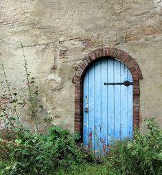 Old arched blue door, Deventer, Netherlands.  Photo by Linda Schrijver.