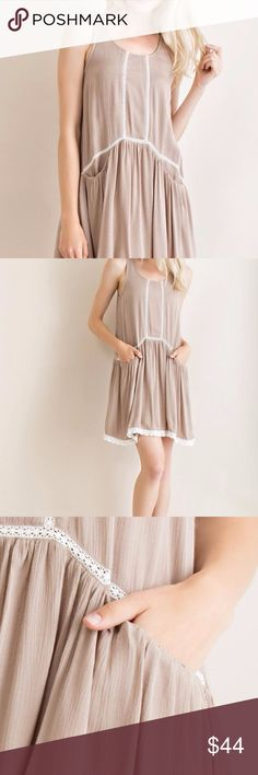 Drop Waist Mocha Dress Mocha sleeveless drop waist dress with delicate lace detail and pockets.  100% Rayon and Poly liner. Dresses Strapless