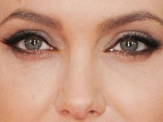 Begin by using the kohl to darken your top and bottom waterlines. The best way to do this is to shut your eye and rub the pencil between your lids, focusing on the outer 3/4, not the inner corner. Clean it up with a q-tip dipped in eye makeup remover to remove any darkness around the eye.