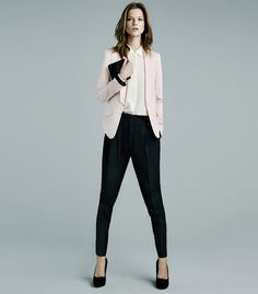 pale blazer with black pants