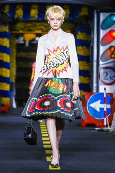 This season, Jeremy Scott wants the Moschino customer to do a hard day's work on a road crew and then wash off the grime with a good scrub down in a car wash. That was the playful sartorial mes...