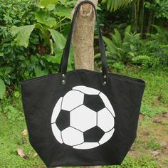 Price:US $5.85 - 5.85. Min.Order   Hot sale Soccer Tote Soccer Purse with PU Handle and Magnetic Snap Closure Team Accessories Women Handbag Material: cotton canvas +210D polyester lining inside   Size: 22*17*8 inch Available Colors : black If you want the buy the your own color , the MOQ for each color is 100PCS Features: Unique soccer printing Maganetic snap closure Inside 1 zipper pockets