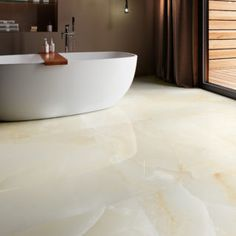 Browse the very latest new porcelain, stone and decorative tiles added to the ever expanding range of natural stone tiles at Mandarin Stone. Blue Living Room Decor, Ceiling Design Living Room, Ceramic Floor Tiles, Tile Floor, Porcelain Tiles, Onyx Tile, Mandarin Stone, Large Format Tile, Vitrified Tiles