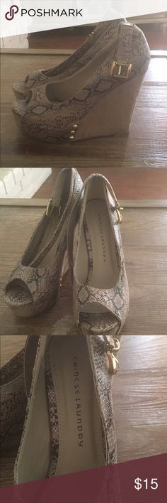 Mock Snakeskin Chinese Laundry Wedges Super comfortable Mock snakeskin wedges. Size 8.5 super comfy. All prices in my closet are negotiable.. I also bundle so check out my closet! Chinese Laundry Shoes Wedges