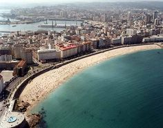 A Coruña, Spain - best promenade to run on in the world....as well as the world's best bread. I want to go back.
