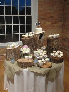 this would be a cute idea to have maybe one or two low stumps on the grassy part of the table to raise the levels up to add the natural feel