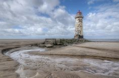The abandoned Point of Ayr Lighthouse in Wales. More --> http://www.abandonedplaygrounds.com/point-of-ayr-abandoned-lighthouse-in-wales-y-parlwr-du/