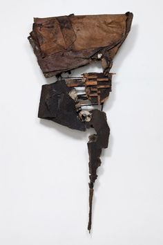 Robert Mallary, Jouster, 1960. Wood, steel, cardboard, tarpaper, dirt and polyester resin, 259 x 126.3 x 22 cm / 102 x 49 3/4 x 8 5/8 in. Courtesy of Hauser & Wirth  Mallary's sculptures and assemblages, made from abject materials draped over wood and metal frames