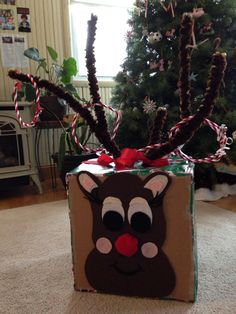 Reindeer ring toss game for Winter Holiday party at school. Saw this on Pinterest. Just put my own twist on it. Rings made from pipe cleaners and embellished with bells.