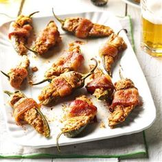 Sweet & Spicy Jalapeno Poppers Recipe -There's no faster way to get a party started than with these bacon-wrapped poppers. Make them ahead and bake just before serving. Even the hot pepper intolerant will love them.—Dawn Onuffer, Crestview, Florida