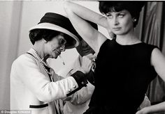 Attention to detail! Chanel makes an adjustment to a dress during a fitting before her runway show
