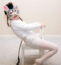 Zebra mask and tail for children. Fun dress up toy for pretend play. Easy to put on zebra costume for Halloween or Carnival.
