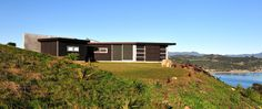 Cooks Beach house by Crosson Clarke Carnachan Architects. I love how this still looks like a simple kiwi bach!