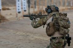 U.S. Army Ranger fires an M4 carbine in close quarter marksmanship training