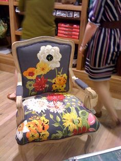 Needlepoint chair...could be crewel.  Love how the design is partial on the upper part of the chair