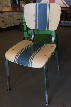 Vintage industrial school chair painted with Chalk Paint® Annie Sloan in Old Ochre and Aubusson Blue with clear and dark Soft Wax.