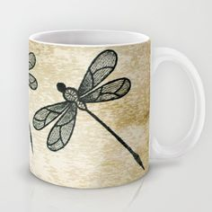 https://society6.com/product/dragonflies-on-tan-texture_mug?curator=hereswendy