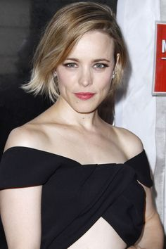 A blunt-cut bob looks cooler when it's asymmetric, so part deeply to the side for uneven weight.    - HarpersBAZAAR.com