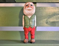 Items similar to Santa with Brown Coat wood carving Created and carved by MADellinger Woodcarving BS # 157 on Etsy Yes I Can, Caricatures, Folded Flag, Oncle Sam, Red Trousers, Red Vest, Wooden Figurines, Black Belt, Hand Carved