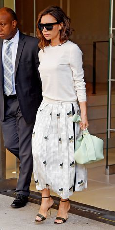 Look of the Day - Victoria Beckham wearing a sweater/skirt combination of her own design.