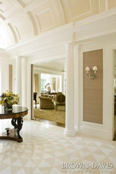 Beautiful hall, calm atmosphere perfect  appication of millwork design look at floors.... wow....dream home interior ...and ceiling just divine!!!