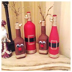 DIY Christmas decor. Reindeer from old whiskey bottles and Santas from old wine bottles.