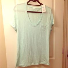 NWT Mint Green Jersey V-neck Tee With Pocket Technically sleepwear, this is a really cute slightly sheer thin jersey top in a gorgeous light mint color. Brand new with tags. 60% cotton, 40% polyester. Gilligan & Omalley Tops