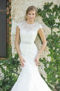 Loving this #lace #vintage wedding gown. The detail around the neckline is stunning! {Madison James}