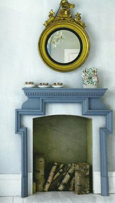 Blue gray surround to fireplace.