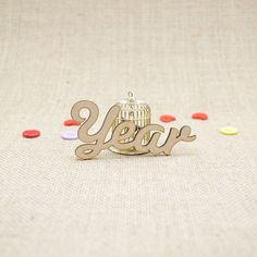 MDF wooden year word shape laser cut from Premium 3mm MDF (Medium Density Fibreboard). Sizes from 3cm to 6cm tall in 3mm thickness.
